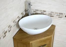 corner sink bathroom. small corner oak bathroom vanity unit sink