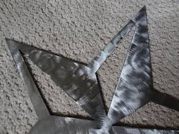 Metal Star Wall Decor Hand Made Star Brushed Metal Wall Art Set Of 3 Large 18 Medium