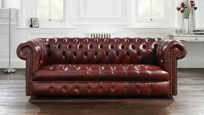 Incredible Living Room Decoration Using Tufted Dark Green Leather Chesterfield  Sofa Along With Light Walnut Wood