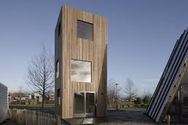 architecture. Skinny Micro Home Spreads Space-saving Tricks Over Three Stories Architecture