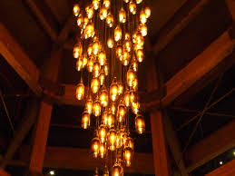 made of repurposed beer bottles the chandelier at hilcrest brewing company casts a warm glow