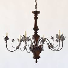 deeply craved wood chandelier with iron arms floine style