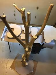 then she counter sank some lag bolts to attach the shelves to the top of each branch