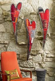 swooping hearts wall sculpture metal wall art created by artist anthony hansen hansen uses found automotive sheet metal to create these patchwork wall  on red metal heart wall art with  garden yard pinterest clay mosaics and crafts