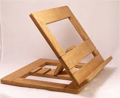 the wooden book stand design has a diagonal framework hold by a piece of wood coming