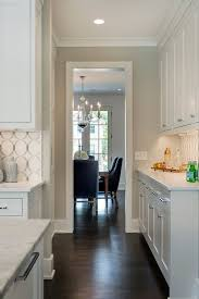 White cabinets: Benjamin Moore Simply White OC-117. Gray walls ...