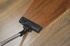 vacuuming hardwood floor