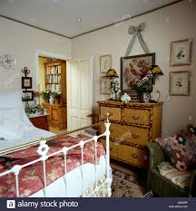 Small Country Bedroom Bamboo Chest Of Drawers In Small Country Bedroom With Pink Quilt