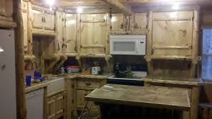 rustic log kitchen cabinets and bar