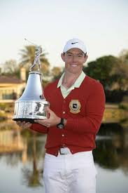 rory mcilroy of northern ireland holds the chionship trophy after winning the arnold palmer