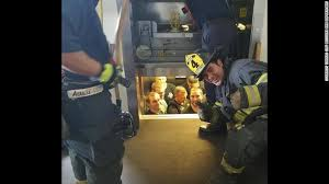 people stuck in elevator. the kansas city, missouri fire department shared this image of police being rescued from an people stuck in elevator