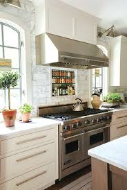 stainless steel vent hood. Beautiful Kitchen Features A Stainless Steel Vent Hood Which Stands Over Marble Tiled Cooktop .