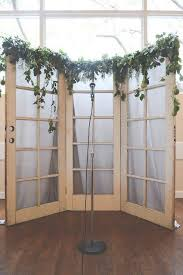 wedding backdrop ideas with greenery and vine old door