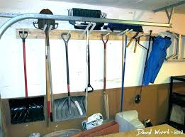 tool wall storage walls garage shelf rack garden tools hang on yard gar lawn cart backyard tool wall