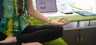 meditation in office. Woman Sitting In Meditation On A Desk At The Office G