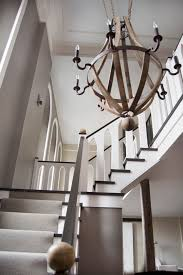 boston foyer light fixtures staircase modern with beige wall iron chandeliers
