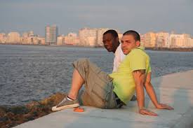 photo essay havana colorful vibrant and alluring planet havana malecon dusk two men relaxing