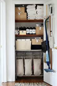 a beautifully organized linen and cleaning closet via bliss at home what a great spot to keep your dirty laundry tucked away
