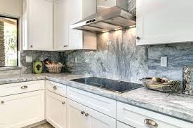 backsplash with white cabinets and grey countertop grey and white cabinets kitchen with white marble counter
