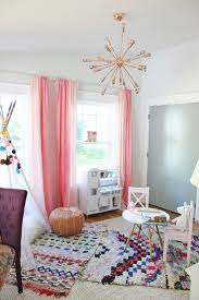 Loving the shades of pink and rose gold in this eclectic playroom. And yes,