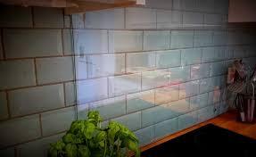 our kitchen diner and lounge reveal elegant glass splashback over tiles