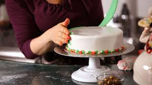 How To Attach Decorations To A Christmas Cake Howcast The Best