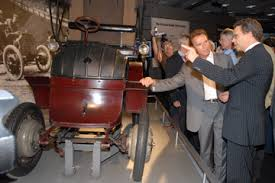 first electric motor car. Porsche Chief Engineer, Wolfgang Duerheimer, Explains To California  Governor Arnold Schwarzenegger That The Lohner First Electric Motor Car