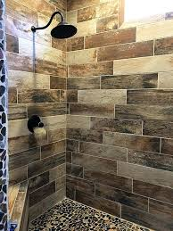 wood look tile in shower please note this tile is no longer available but we do have similar options wood look tile shower with pebble floor wood grain tile