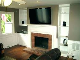 tv installation above fireplace stone