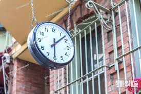big vintage old clock hanging with