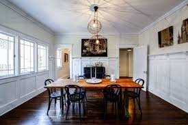 craftsman lighting dining room. craftsman dining room with hardwood floors wainscoting metal fireplace pendant light crown lighting