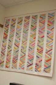 A great way to use scraps. Thin strips sewn together and then cut ... & My Scrappy Braid Strip Quilt at American Quilting - good way to use up  scraps Adamdwight.com