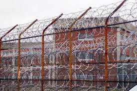 youth jailed at age for years no trial kills self who s razor wire fence surrounding inmate housing at riker s island