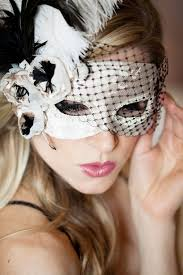 masquerade mask with feathers and veil