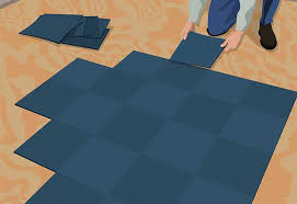lay third square installing carpet tiles
