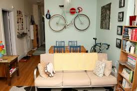 Bike hanger for apartment Storage Solutions If Your Space Is Bit Smaller Vertical Solution Might Be Better Bet The Cycloc Lets You Hang Your Bike Along Any Wall And Gives You Small Storage Livin In The Bike Lane Livin In The Bike Lane Apartment Bike Storage Solutions