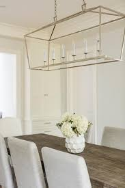 polished nickel linear pendant over dining table
