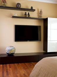 floating shelves around flat screen tv