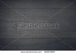 black table top texture. wood grey grain texture, wall background, top view of wooden table black texture