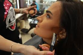 al arabiya s business anchor rania abi nader getting her make up done