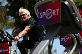 sir richard branson rides an exercise bike in san francisco in may as he announces the