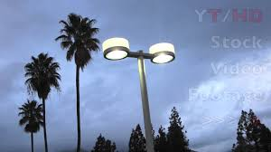 parking lot lighting w two lights design on pole lit up against images with breathtaking commercial