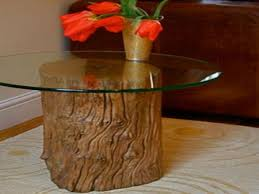 furniture round glass top coffee table with brown tree stump on the rug rustic