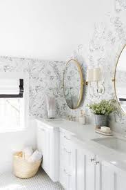 a whimsical neutral kid s bathroom with mixed metals and wallpaper