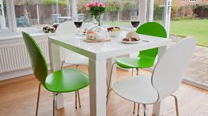 white gloss dining table and coloured dining chairs