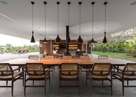 marcio kogan s casa lee concrete house open plan indoor outdoor living pendant lit