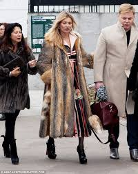 mixing it up she stepped out wearing a long fur coat and frumpy vintage dress