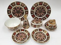 lot 1218 a collection of royal crown derby 1128 pattern comprising bell frame