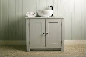 bathroom vanity cabinet with carrara marble top and countertop sink painted in modernist white