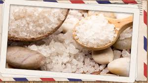 a warm and relaxing picture of natural bath salts and dead sea salts in a wooden